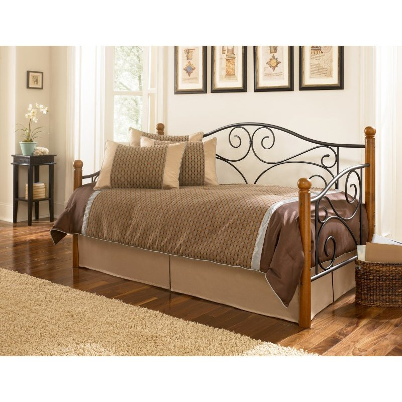 Fashion Bed Group Doral Metal Daybed Frame with Scrolled Spindle Panels and Walnut Hardwood Finial Posts - Matte Black Finish - Twin