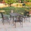 International Caravan Mandalay 7-Piece Iron Outdoor Dining Set in Bronze