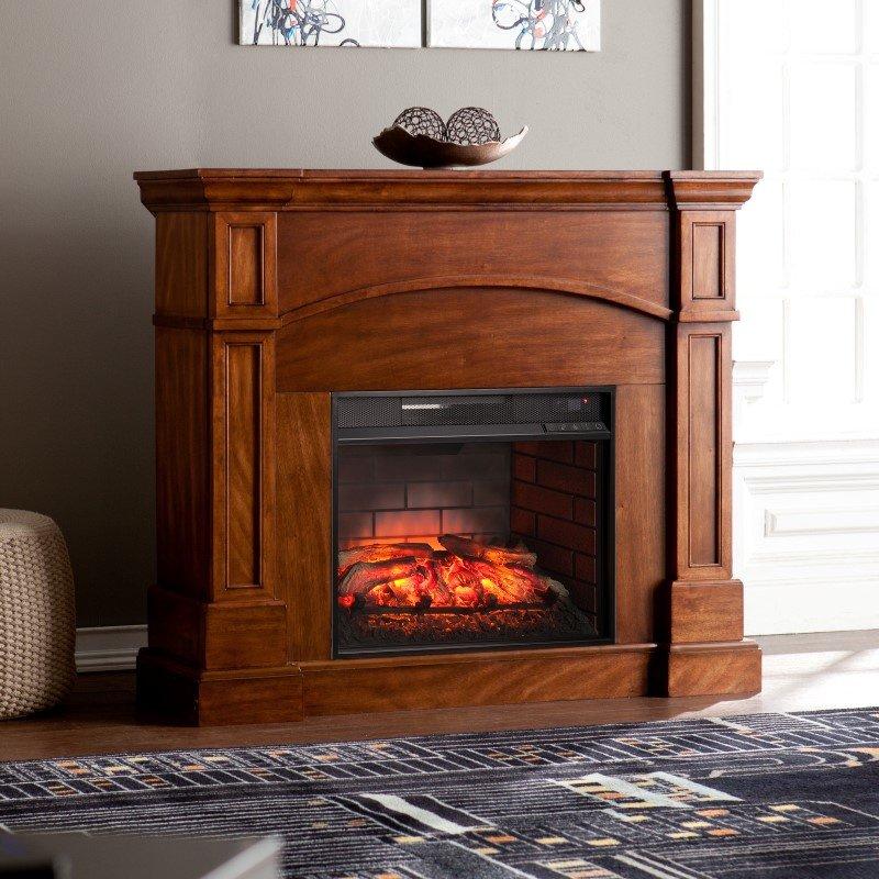 Southern Enterprises Lantana Corner Convertible Infrared Fireplace in Oak Saddle